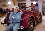 "Jay Leno, host of ""The Tonight Show,"" collects rare and fast cars - including this antique fire truck - as a hobby. Leno is marking his 15th year as host of  the show tonight."
