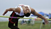 Lawrence High's Kevin Logan clears 6-6 in the high jump. Logan earned the gold medal at the 6A state track meet Friday in Wichita.