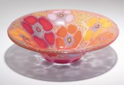 "This slumped bowl with a flower design is engraved ""Higgins."" It is 8 inches in diameter. The bowl sold recently at Treadway Gallery in Cincinnati for $180."