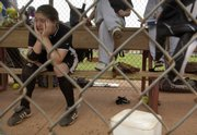 Free State High's Kayley Lane sits in the dugout after the Firebirds' loss to Derby. Free State fell in the semifinals of the 6A state softball tournament Saturday in Wichita.