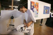 """During the sixth annual """"Sentenced to the Arts"""" gallery showing Tuesday, 15-year-old Christopher Van Bibber displays his talent as he makes a painting of the the Eiffel Tower in Kansas City, Mo. The program gives troubled youth an outlet channeling their energy and emotions."""