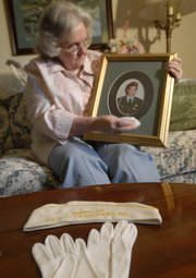When Virginia Harris, Lawrence, puts on the white gloves, hat and dress of the American Gold Star Mothers, an organization of mothers who have lost sons or daughters in military service, her hope is to help other families who have similarly suffered. Harris, one of two Lawrence women who are members of Gold Star Mothers, is pictured at her home with a photo of her son Tim, who died in the Army during a training accident in 1986 in Germany. He is buried at Fort Leavenworth, where Harris will participate today in Memorial Day services.