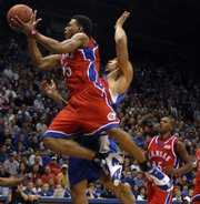 Kansas University's Brandon Rush lunges toward the bucket past Tennessee State forward Clarence Matthews. Rush will have surgery to repair his torn ACL, and KU coach Bill Self hopes Rush's knee will be healthy by Nov. 1.