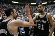 SAN ANTONIO FORWARD TIM DUNCAN (21) high fives teammate Manu Ginobili following the Spurs' victory against Utah in Game 4 of the Western Conference finals. San Antonio took a 3-1 series lead with Monday's win, and will look to close out the Jazz tonight.