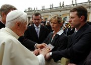 Pope Benedict XVI blesses a photograph of missing 4-year-old Madeleine McCann as her parents, Kate and Gerry, right, touch his hands during his weekly general audience in St. Peter's Square at the Vatican. The pope spoke a few words with the parents, and blessed them and the photograph as he greeted visitors in the front row during his audience. Madeleine went missing on May 3 while vacationing with her family in Portugal.