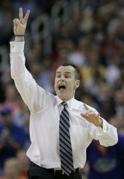 FLORIDA COACH BILLY DONOVAN signals to his team during a Final Four game against Ohio State. Donovan, who led the Gators to their second straight NCAA title in April, decided Thursday to become coach of the NBA's Orlando Magic.