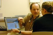 Dr. Steven Bruner of Lawrence Family Medicine & Obstetrics explains to a patient in his office that some people have trouble self-diagnosing using the Internet.