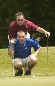 Conrad Roberts, front, and Chad Roesler study a green at the KGA Four Ball Tournament. The pair of former Kansas University golfers won the event. The teammates will vie against one another at the Lawrence Amateur Golf Association city championship next weekend.