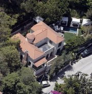 Paris Hilton's home in the Hollywood Hills is shown in this aerial view. Hours after Hilton was sent home under house arrest Thursday, the judge who originally put her in jail ordered her back to court to determine whether she should be put back behind bars.