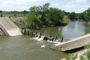 Recent rains caused erosion underneath portions of the dam at the Kickapoo Indian Reservation northeast of Topeka. Tribal officials met with federal officials Thursday to consider solutions for repairing the dam.