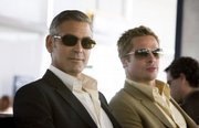 "George Clooney, left, and Brad Pitt return in the crime caper ""Ocean&squot;s Thirteen."""