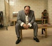 "James Gandolfini portrays Tony Soprano in a scene from one of the last episodes of HBO&squot;s ""The Sopranos."""