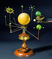 A set of models of the sun, earth and planets, with gears and pulleys to show their movement, is called a planetarium. This one excited bidders at a recent Skinner auction in Boston. It was one of several parts of a 19th-century school set that sold for $44,000.
