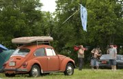 A mattress rests on a small volkswagen as people begin to pack and leave the Wakarusa Music and Camping Festival at Clinton Lake on Sunday.