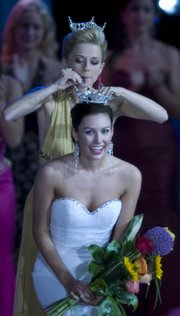 The new Miss Kansas 2007, Alyssa George, formerly Miss Sedgwick County, is crowned by Miss Kansas 2006, Michelle Walthers. George is a Kansas University student but plans to take the next year off because of her Miss Kansas duties.