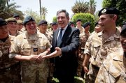 "Chancellor Gordon Brown, Britain&squot;s next prime minister, meets British troops in Baghdad during a visit to the region. Brown flew into Baghdad on Monday and pledged to ""learn the lessons"" of events in the run-up to the conflict. Brown hasn&squot;t outlined what his specific policies on Iraq will be, though he has indicated that he wants to devote more time and resources toward the creation of jobs and basic services."