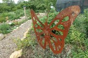 The butterfly garden behind Foley Hall on KU&#39;s West Campus is marked by paths that take visitors through a peaceful, natural setting.