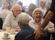 Lawrence resident Nancy Hambleton, right, sits with her husband, William Hambleton, retired director of the Kansas Geological Survey, and socializes with other members and guests of the Endacott Society over coffee. The group had its annual meeting June 13 at Adams Alumni Center.