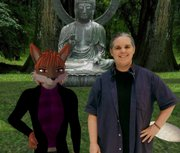 Stacey Fox, Kansas University's film studies technical director, stands next to her online avatar in a computer-simulated virtual reality screenshot. Fox, an expert in building, designing and filming in virtual reality, is a key source in the film department's plans to teach virtual reality to students. Fox is pictured on Friday.