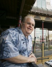 Lou Pearlman poses outside his offices at Church Street Station in Orlando, Fla., on  Oct. 27, 2006. Pearlman, who fled the country earlier this year and had not been seen for months, was arrested Thursday after Indonesian officials kicked him out of that country.
