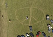 A peace sign mowed in the grass decorates the lawn at the Wakarusa Camping & Music Festival last Friday evening.