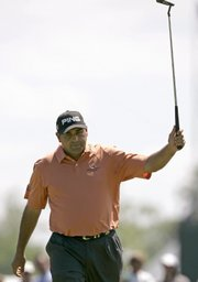 Current leader Angel Cabrera acknowledges applause after a birdie on the 13th hole.
