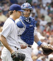 Chicago catcher Michael Barrett, right, talks to starting pitcher Rich Hill during the Cubs' loss to the Padres on Sunday in Chicago. Barrett and Hill had an animated argument in the dugout last week after Hill ignored advice from Barrett.
