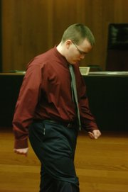 Jason Allen Rose walks out of court Monday morning after receiving a 122-month sentence for the October 2005 fire at Boardwalk Apartments in the 500 block of Fireside Drive. Three people were killed in the fire, and 17 others were injured.