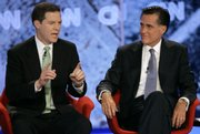 Republican presidential hopefuls Sen. Sam Brownback, R-Kan., left, and former Massachusetts Gov. Mitt Romney take part in a political debate in Manchester, N.H., in this June 5 file photo. A campaign aide for Brownback has been reprimanded for sending derogatory e-mails concerning Romney's Mormon faith.