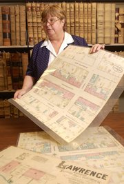 Sherry Williams, curator of the Kansas Collection at KU's Spencer Research Library, is the interim Spencer Research librarian. Williams displays some 1883 Sanborn maps of Lawrence from the Kansas Collection.