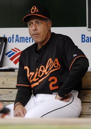 Sam Perlozzo sits in the dugout prior to a game against the Arizona Diamondbacks in this file photo from Friday in Baltimore. Perlozzo was fired as the Orioles' manager Monday.