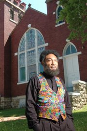 C. Everett Pace will portray Langston Hughes as part of the Baldwin City Chautauqua, which runs today through Sunday at Baker University. Pace stands outside St. Luke's A.M.E. church at Ninth and New York streets in Lawrence, which Hughes attended as a young boy.
