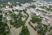 Flood waters are seen in and around the downtown Gainesville, Texas, area on Monday. Up to eight inches of rain fell in parts of north Texas since midnight Monday, swamping the towns of Gainesville and Sherman near the Oklahoma border.