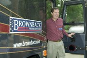 Presidential hopeful Sen. Sam Brownback, R-Kan., steps off his campaign bus at a stop in Adel, Iowa. Brownback kicked off his summer road trip Monday, a 1,200-mile, four-day, 27-stop tour through Iowa.