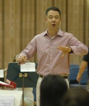 Scott Weiss, Kansas University's new director of bands, conducts a rehearsal during the Midwestern Music Camps in June at KU. He previously was associate director of bands and associate music professor at Indiana University's School of Music.