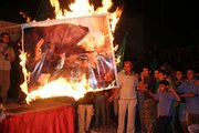 Hamas supporters burn a poster of Palestinian President Mahmoud Abbas and U.S. Secretary of State Condoleezza Rice during a protest against a speech made by Abbas condemning Hamas. The protesters were in the Jebaliya refugee camp in the northern Gaza Strip.
