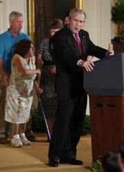 President Bush speaks about embryonic stem cell research in the East Room at the White House. Joining him Wednesday at left was Kaitlyne McNamara of Middletown, Conn., who was born with spina bifida, along with her parents, Mike and Tracy.