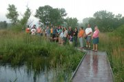 The Public was invited to attend a Sunrise Ceremony at the Wakarusa Wetlands on Thursday as part of the National Day of Prayer to Protect Native American Sacred Places. The event was sponsored by Save the Wakarusa Wetlands Inc. and the Morning Star Institute.