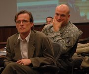 "Bart Dean, left, an associate professor of anthropology at Kansas University, and Lt. Charles Bartles listen to an audience member&squot;s comment during the ""military-social science roundtable"" Thursday at Fort Leavenworth."