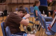 Alex Gregory, of Crane, Texas, takes a rest on her French horn shortly before full orchestra rehearsal Thursday afternoon during the Midwestern Music Camp at Kansas University's Murphy Hall. A new study, published this month by a KU music professor, shows that schools with high-quality music programs also tend to have higher standardized test scores.