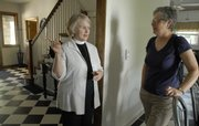 The Rev. Susan Terry gives a tour for Catherine Anderson, Somerset, Mass., at the recently renovated Canterbury House, 1116 La. The site will be used as offices for the Episcopal ministry, which plans to retool its programming and outreach efforts throughout the eastern half of the state.