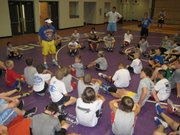 Former Olympic wrestler Ken Chertow speaks to campers at his Gold Medal Training Camp. Chertow had about 80 visitors to his camp Friday in Baldwin City.