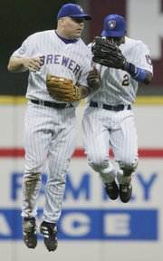 Milwaukee's Kevin Mench, left, and Bill Hall do a happy dance after the Brewers beat the Royals, 11-6. The Brewers won Friday in Milwaukee.