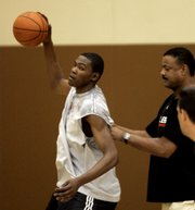 Forward Kevin Durant, left, maneuvers against Portland Trail Blazers assistant coach Maurice Lucas during a workout at the Blazers' practice facility. Durant worked out for the team Friday in Tualatin, Ore.