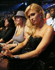 Paris Hilton sits in the audience during the MTV Movie Awards on June 3 in Los Angeles. NBC and ABC television networks are trying to distance themselves from the hotel heiress, who is expected to be released from jail soon. ABC says it turned down a Hilton family offer for a post-jail interview, and NBC says it is interested only if no money is involved.