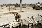 An Iraqi soldier secures the area Thursday in Baqouba, Iraq, 35 miles northeast of Baghdad. The U.S. military began a major campaign against Sunni insurgents Monday in the area surrounding Baqouba, the capital of Iraq's Diyala province.