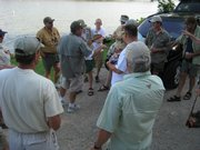 Free State Fly Fishers gather for a discussion of the rules for their first tournament. The event was Wednesday at Lone Star Lake.