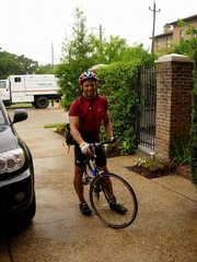 Kansas University's director of strength and conditioning Chris Dawson reaches his final destination, Houston, after an 805-mile, seven-day solo bike trip. Dawson completed the trip May 18-24.