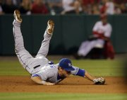 Kansas City third baseman Alex Gordon makes a diving stop on a ball hit by the Angels' Casey Kotchman. The stop prevented a run from scoring in the ninth inning of the Royals' 5-3 victory Monday in Anaheim, Calif.