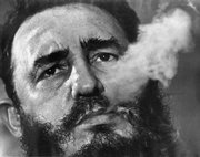 Fidel Castro exhales cigar smoke in this March 1985 file photo during an interview in Havana. Newly declassified CIA papers released Tuesday detail a plot to have American mobsters try to kill the Cuban leader in the early 1960s.